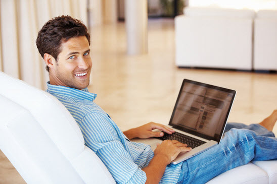 man-surfing-internet-on-laptop-and-smiling-xs